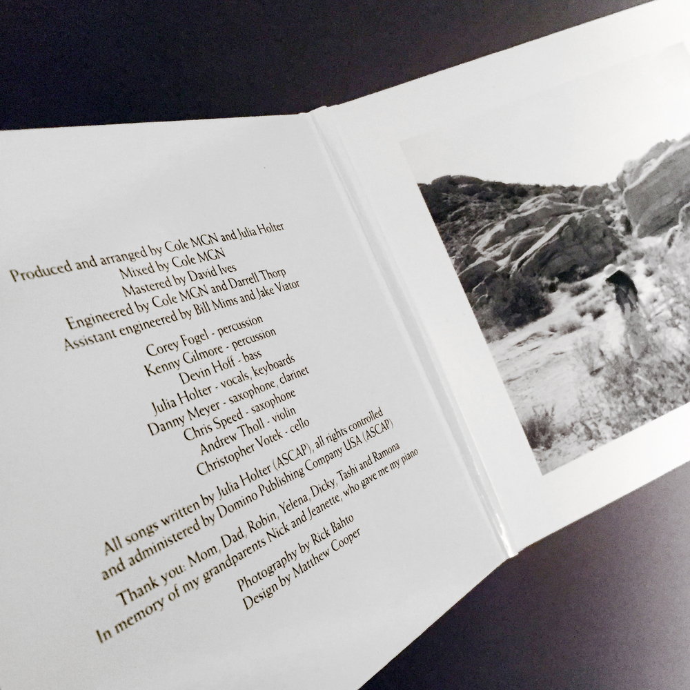 The credits on the inside flap, with a black-and-white photograph on the opposite flap.