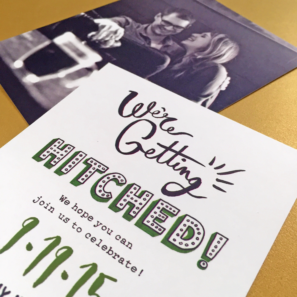 The save-the-date card includes hand-lettering, as well.
