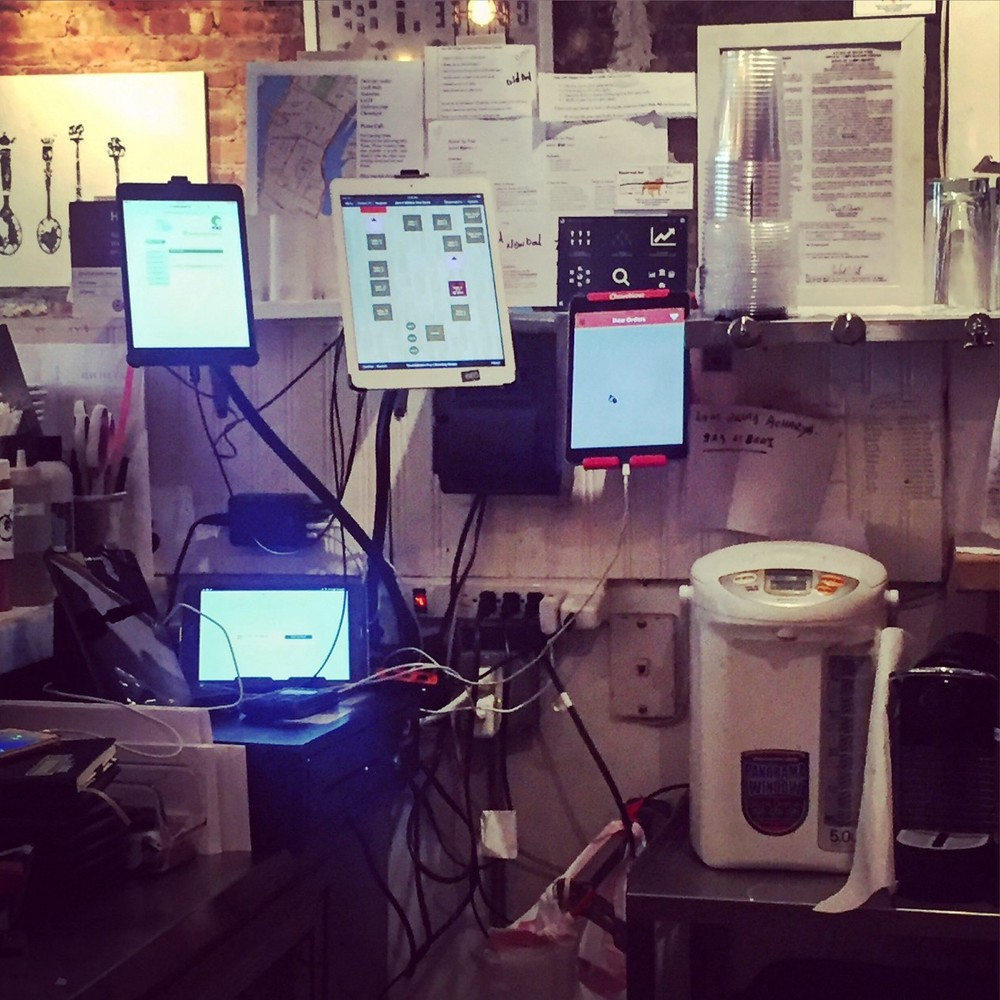 The multiple tablet screens behind the counter at  Jack's Sliders and Sushi  help the hostess facilitate delivery orders from on-demand platforms.
