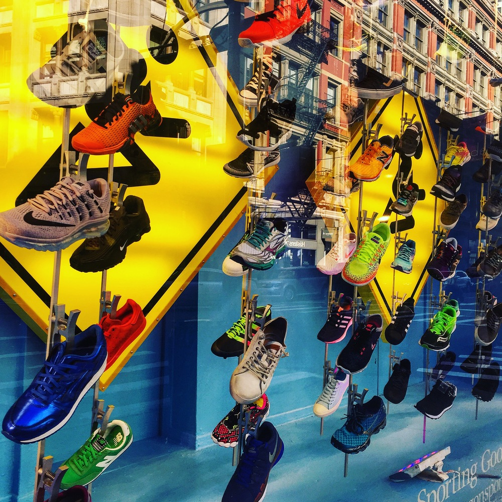 A display of running shoes outside of Paragon Sporting Goods Company in Union Square.