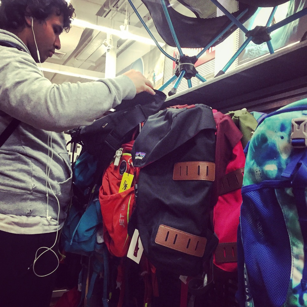 Trying on backpacks was very common among all the customers in the department.