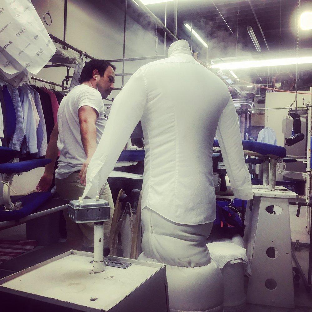 Air is blown through a garment on the line.