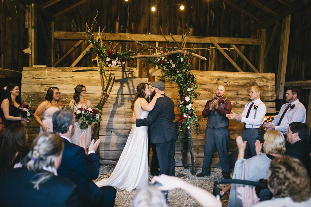 The old drive shed on the venue property quickly became the back up ceremony site as the rain came. I must say, it turned out pretty darn beautiful and perfectly intimate.