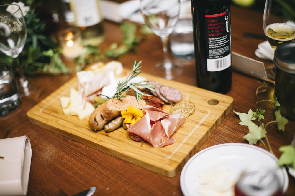 In place of passed hors d'oeuvres, the couple opted for placed charcuterie boards. Which doubled as gifts to their guests!