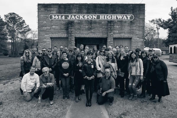 The crew assembles in front of Muscle Shoals Sound Studio.