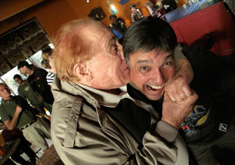 Wrestler, Stuntmanm Gene LaBell biting my ear off.
