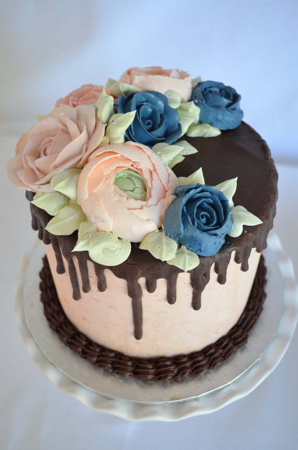 Chocolate drip with buttercream flowers