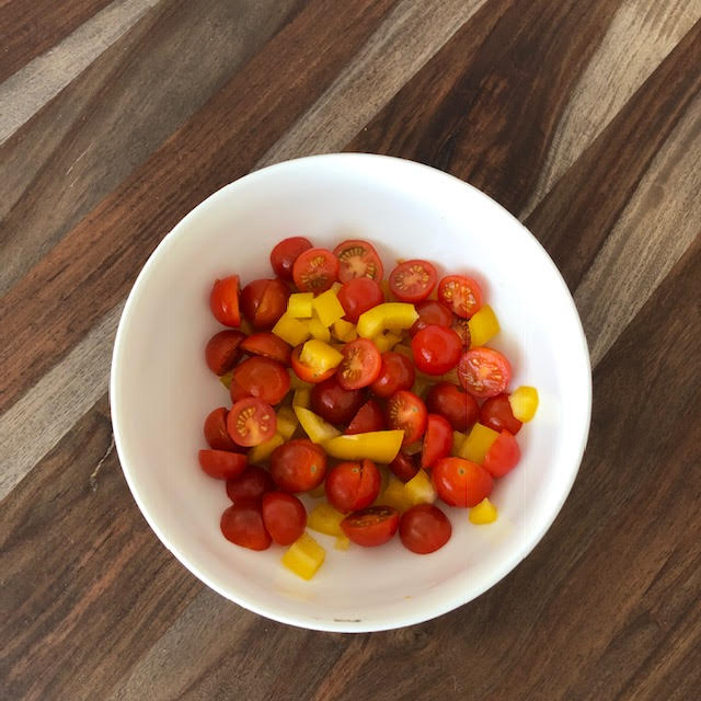 Step 1:  Cut up your veggies of choice. I used baby tomatoes and bell peppers which are both high in vitamin C which is needed for a healthy immune system and helps your skin glow.