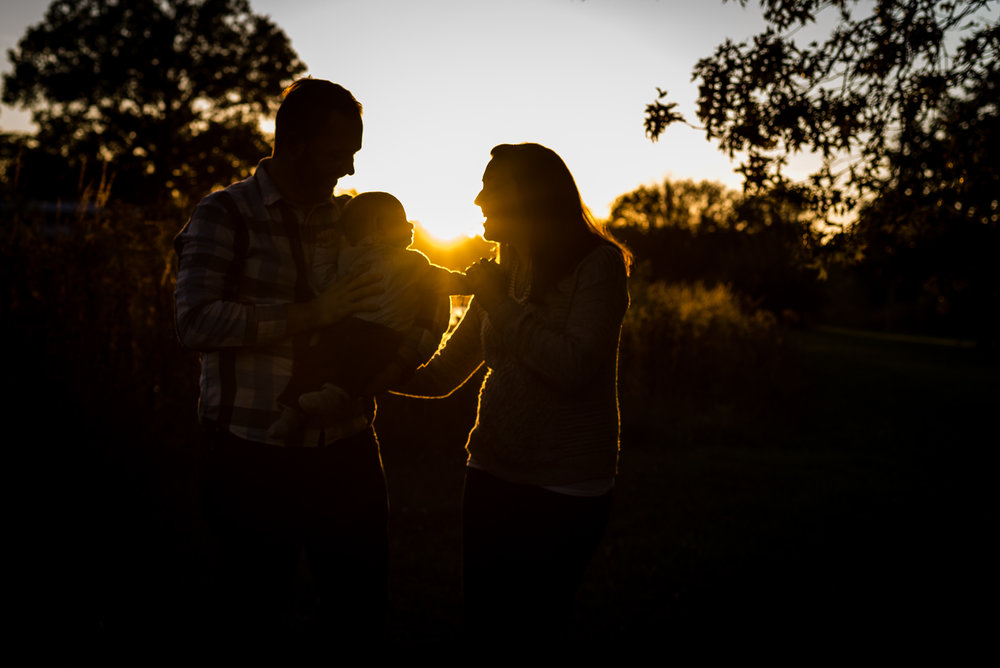 I got to take family photos for Scott and Paige and their son Caleb this fall. It was so much fun capturing the joy of these new parents. As the sun began to set, we began to walk back to the car. With the setting sun blazing into my eyes, I worked on getting a silhouette of this special family. I love this picture as it shows the connection and love Scott and Paige have with their new son. It also reminds me that even in our youth, we are living in the shadow of time that soon sets on us all. Take time each day to love the special people in your life.