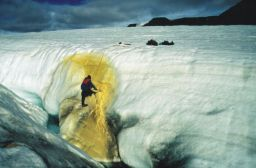 Steve Grasby sampling sulfur from a glacial crevasse in 2000 (Credit:  Steve Grasby )