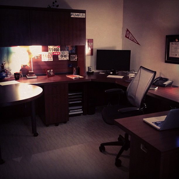 My office at The DeMoss Group. I work best in dim lighting for some reason