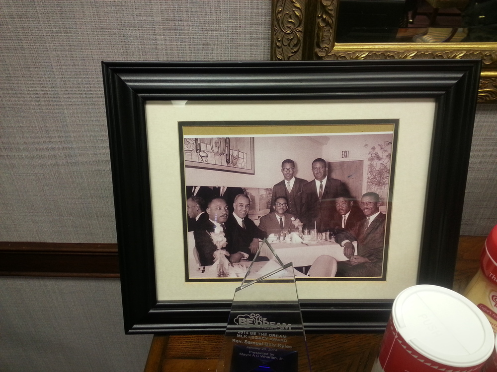 "Historic photo of Reverend Samuel ""Billy"" Kyles, Dr. Martin Luther King Jr. and other luminaries featured in Rev. Kyles's office at Monumental Baptist Church in Memphis. Photo by Vincent L. Stephens."