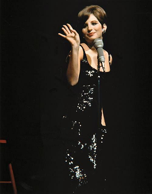 "Rock era crooners such as Barbra Streisand, who has roots in ""non-rock"" fields like cabaret and musical theater, still record and tour successfully. How has mainstream rock hisotry addressed the continuity of these musicla stlyes?"