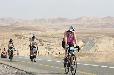 Jane climbing through the not flat desert