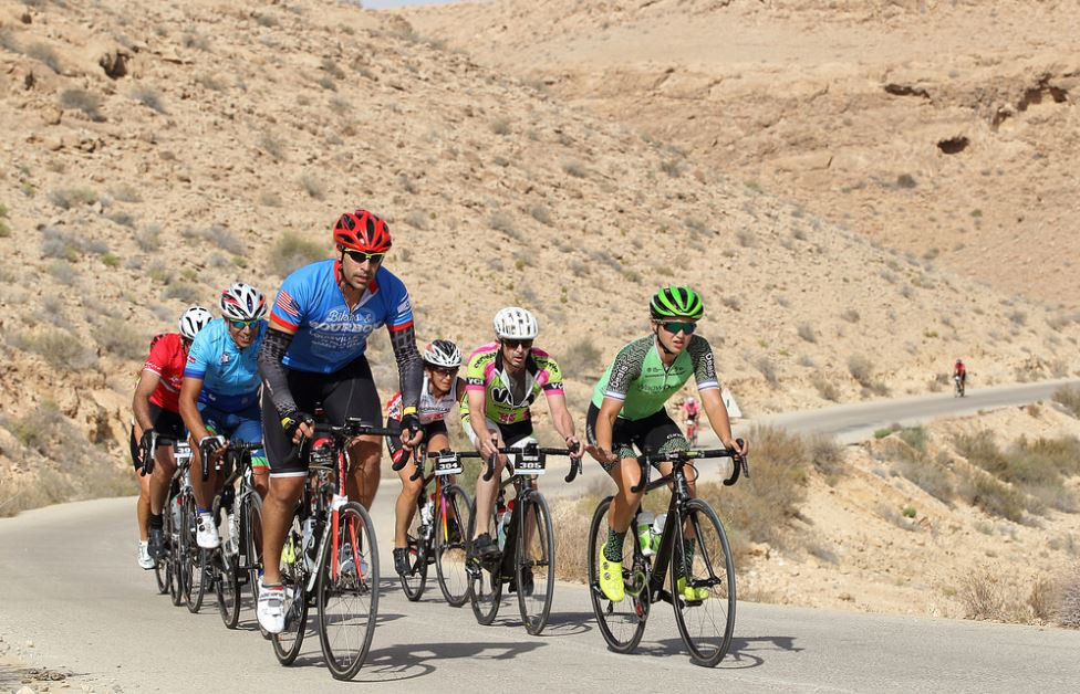 Climbing together with our Israeli Professional Rider (in green kit) leading the way