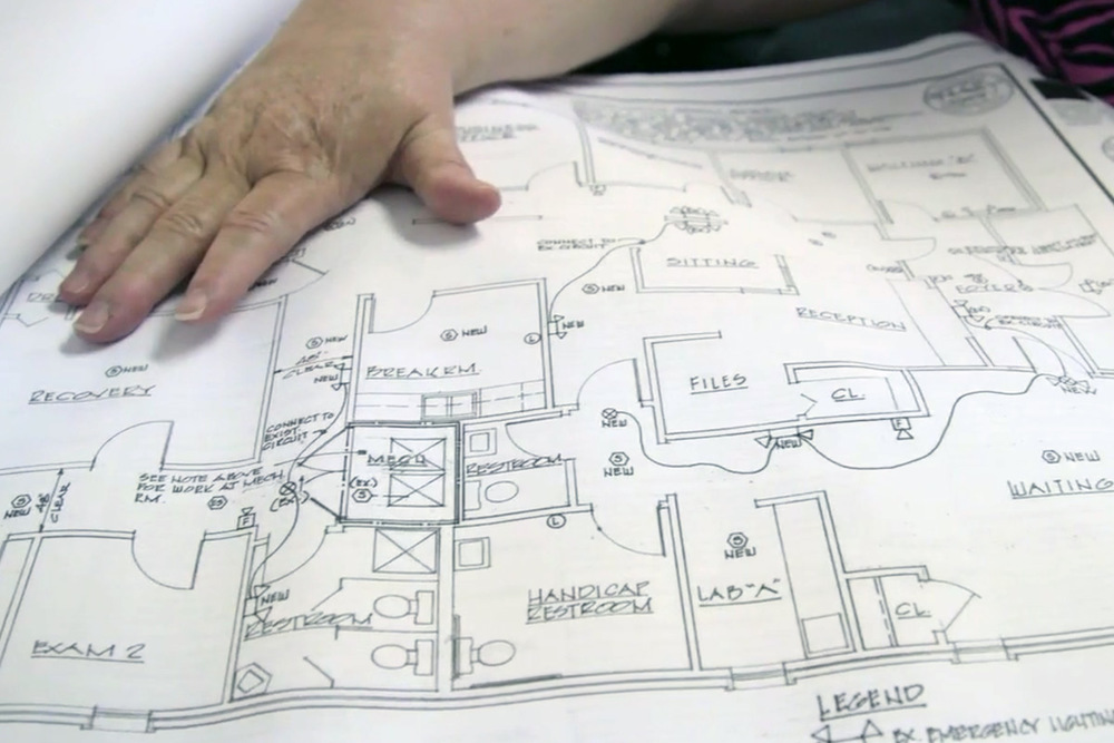 June Ayers, co-owner of Reproductive Health Services in Montgomery, Ala. displays blueprints for changes to her clinic that are necessary to adhere to new state guidelines.