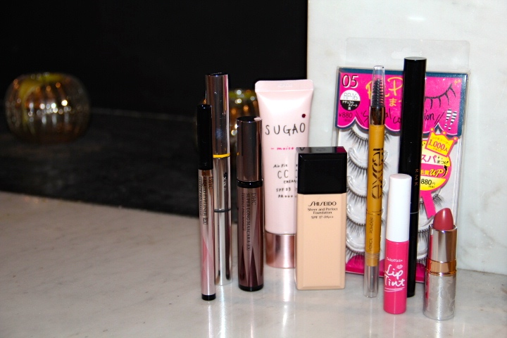 And this doesn't include the skincare...From left: DHC liquid eyeliner, RMK dual lash mascara, DHC Super Long Lash mascara, SUGAO Air Fit CC Cream, ShiSeido Sheer and Perfect Foundation, Excel Brow Pencil, RiPi False Eyelashes, RMK dual shadow stick, BabyPink Lip Tint in Pink, DHC Moisture Lip Lipstick