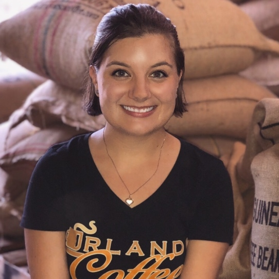 Julia - Marketing Director - Julia enjoys working at Orlando Coffee Roasters because she loves coffee and is excited to come to work and be able to learn about and drink the different types of coffee. She says she's blessed to be able to get to work with something she loves and is happy to come to work.