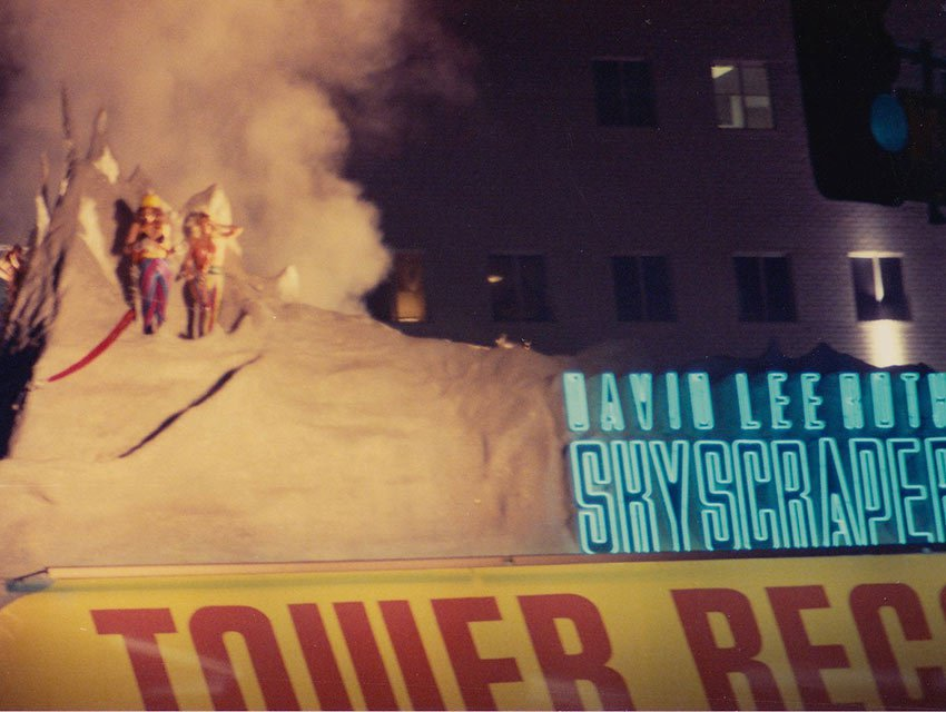 "David Lee Roth delivers his album ""Skyscraper"" by repelling down a replica of the Matterhorn on the roof of Tower Records. Photograph courtesy Debbie Roszkowski"