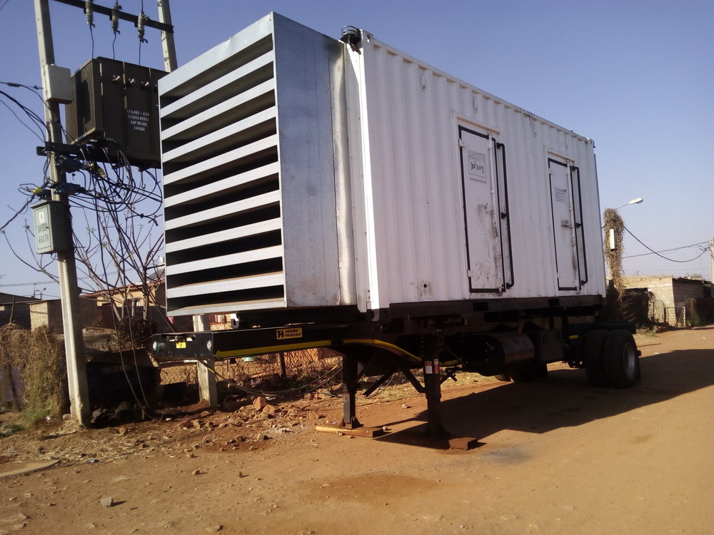 A diesel engine generator serving as a replacement to the broken transformer.