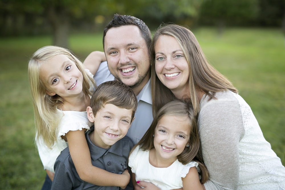Side note....I think this was my absolute FAVORITE image from their session! Everyone smiling and hugging!