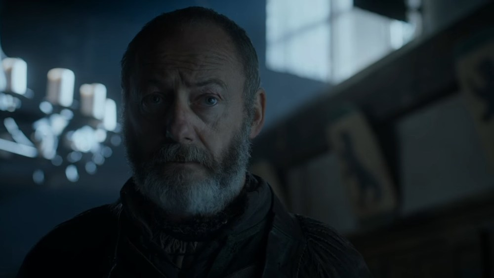 That's a bear in the flag behind Davos which is the sigil of House Mormont