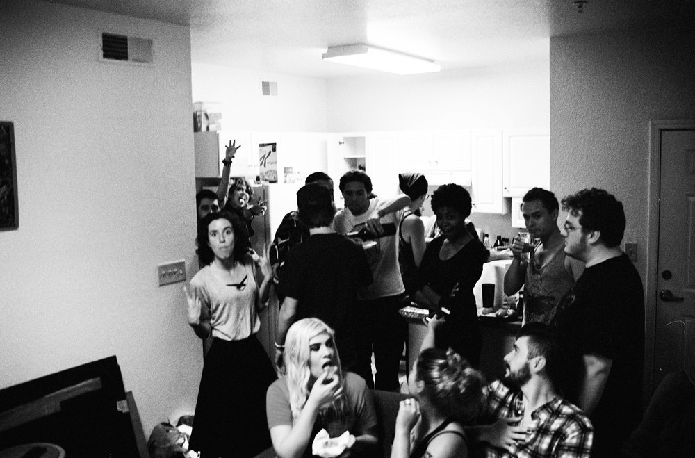 One side of the room at our biggest pizza night we had in college.