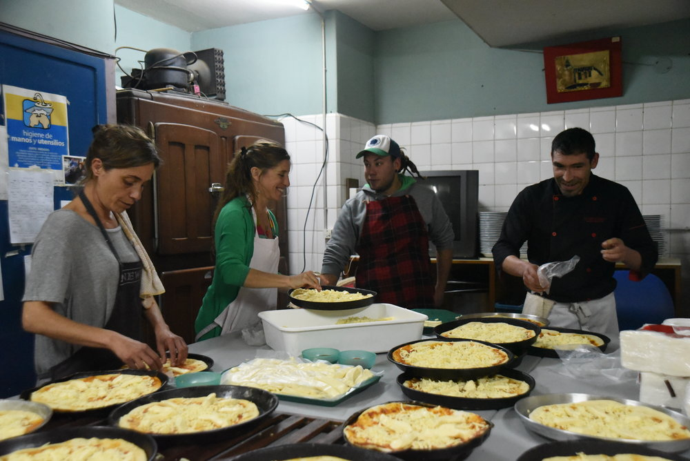 Cooking pizza at Cre-Arte
