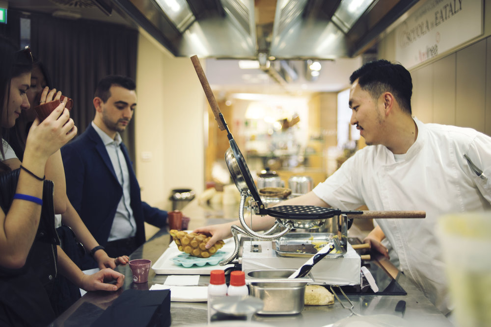 Caleb Ng is serving the Hong Kong signature eggette to the Italian crowd in Eataly, the biggest Italian supermarket in Italy.