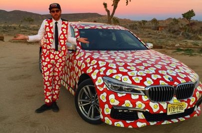 Philip Colbert with the BMW he transformed in LA