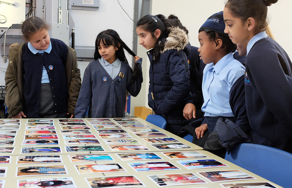 Year 5 pupils looking at their own archive portraits!