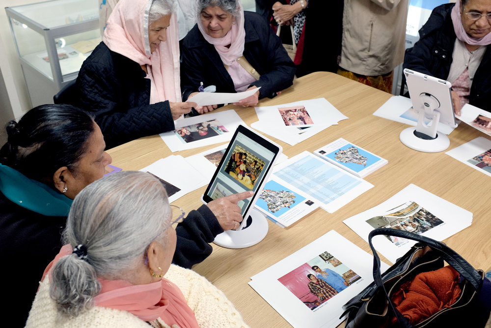 St Chad's Asian Ladies group learn to browse the archive physically and online.