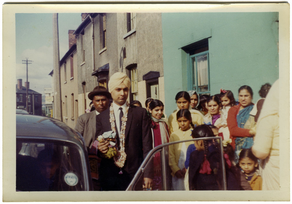 Faqir Singh leaves home for the ceremony of his wedding, Dartmouth Street, West Bromwich, 1965.