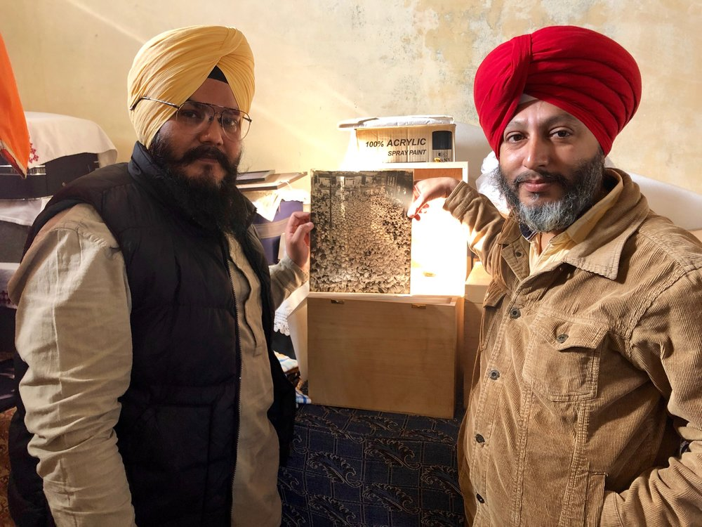PUNJAB, AMRITSAR  - Two rising stars Hardeep and Sandeep with holding one of the 10x8 glass plates contained within handmade boxes they have collected over 6 years in with a focus in Sikh History in Punjab. This had to be one of the main highlights of journey as its an incredible collection and professionally and lovingly archived.