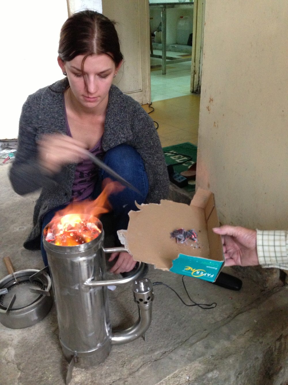 Cana Little, of fi-lan-thro-pe, will demonstrate these in remote farming communities. Once the top layer is alight, remove charred cardboard and place burner on top