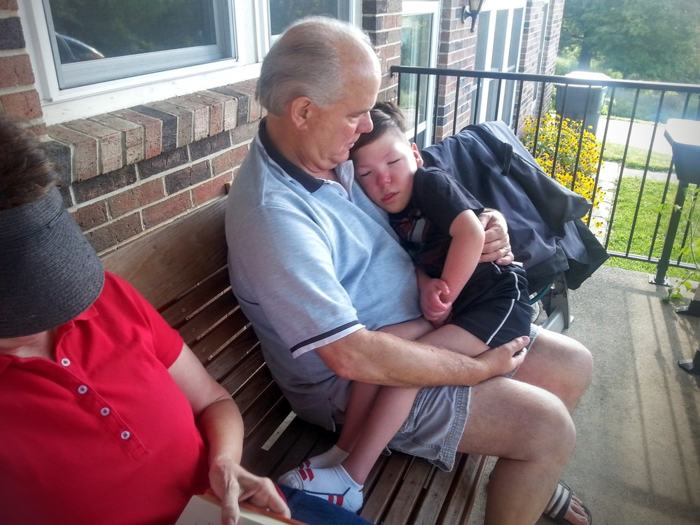 Granddad getting his Collin Time and Nana patiently waiting her turn.