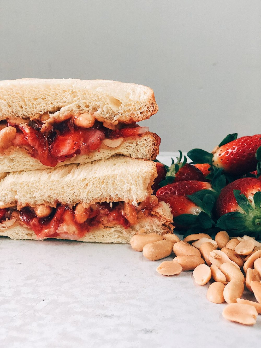 PB+J #1 - Our first PB+J idea comes from Chef Peter Lemon of Wax Paper in LA.Take potato bread and layer with creamy peanut butter, Strawberry Bourbon jam, fresh peanuts, and freshly cut strawberries. For easiest sandwich eating, cut in a diagonal!