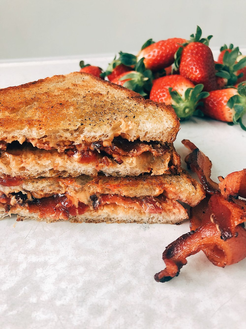 PB+J #3 - Our last PB+J idea comes from Chef Casey Rebecca Nunes of Media Noche in San Fransisco.First mix some sambal (buy it here) with creamy peanut butter. Then fry up some bacon and layer your bread with spicy peanut butter, Strawberry Bourbon jam, and bacon. Add a tablespoon of butter to the skillet and fry sandwich on both sides.