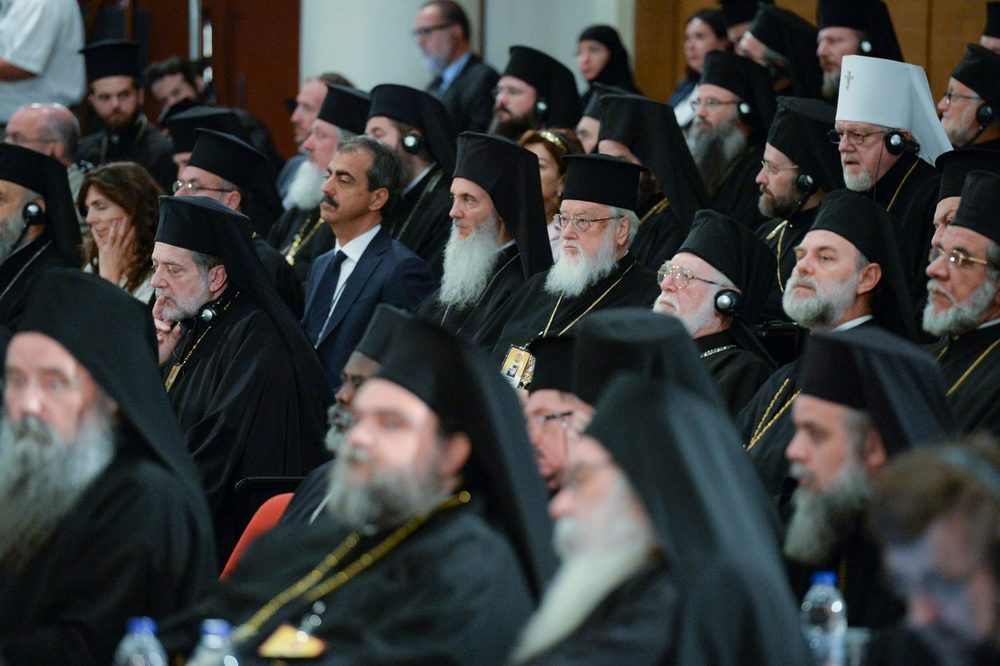 On June 20, 2016, the primates of the Local Orthodox Churches and their delegations participate in the Opening Session of the Holy and Great Council of the Orthodox Church at the Orthodox Academy of Crete. Here, we see (center) His Eminence Metropolitan Kallistos of Diokleia and His Eminence Metropolitan Ambrosios of Korea, both of whom minister to Orthodox in the so-called diaspora. PHOTO: © JOHN MINDALA.