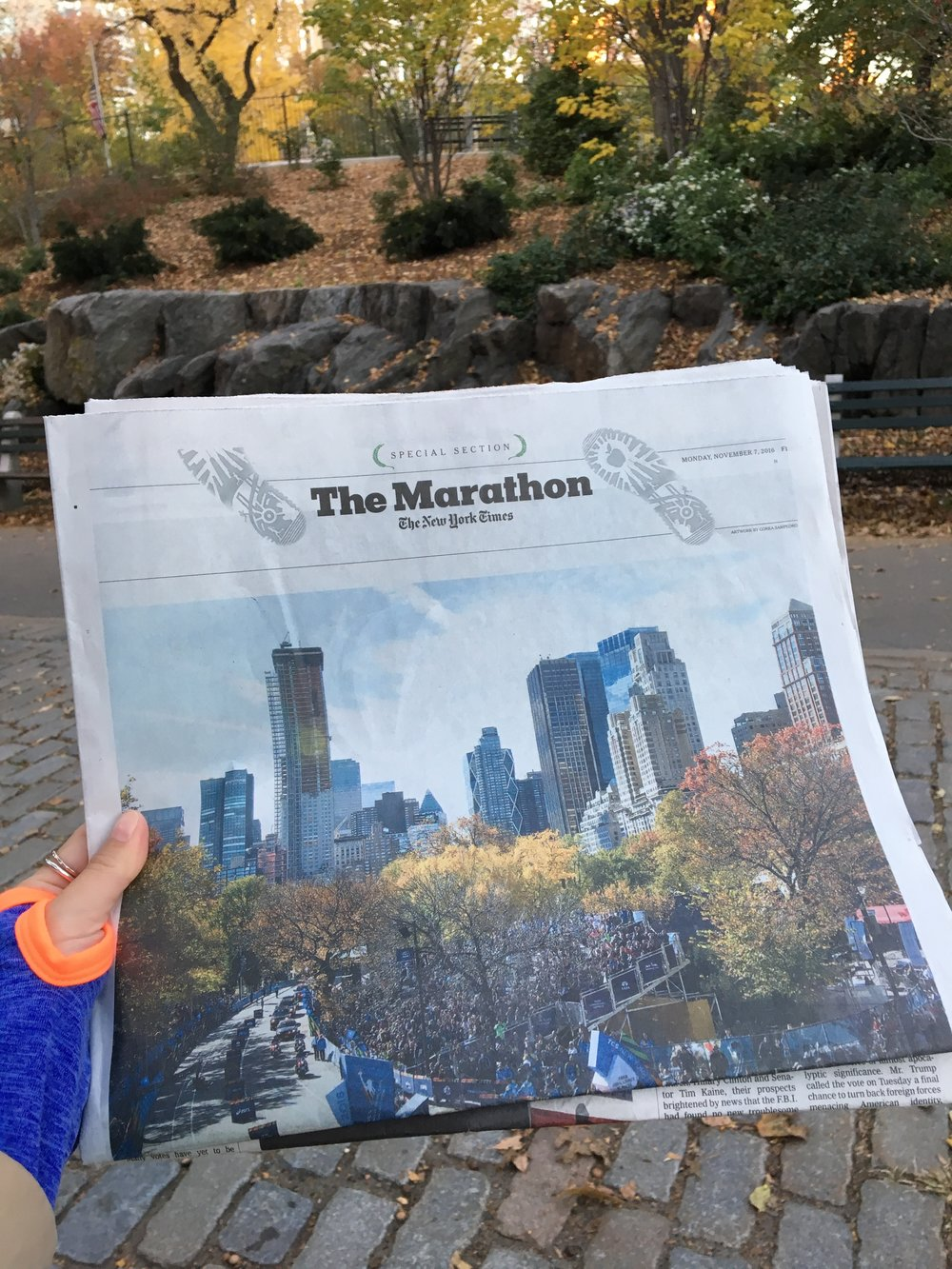 Reading The Marathon section of the New York Times in Central Park the day after the race.