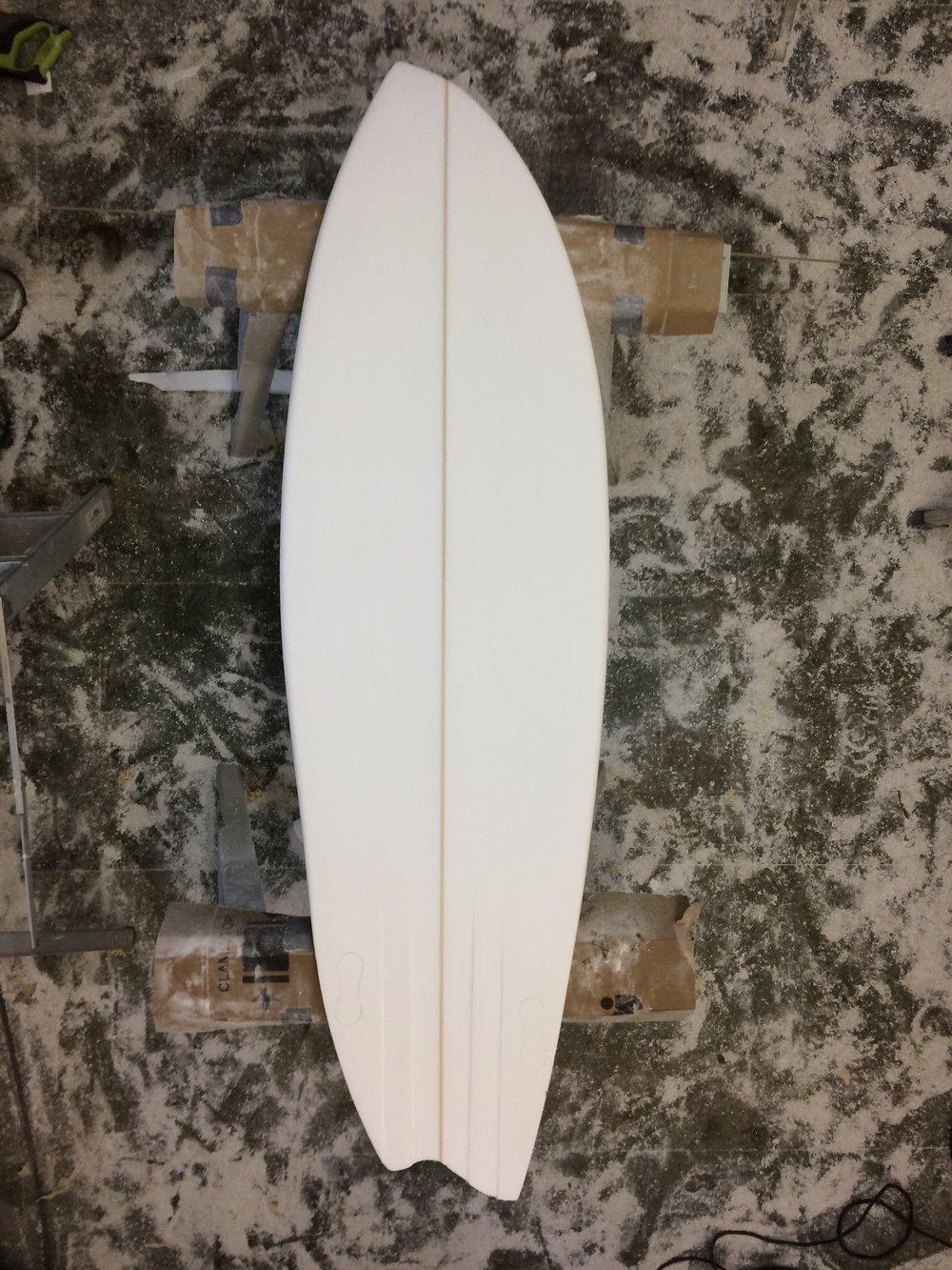 Shaped asymmetric surfboard from top.jpg
