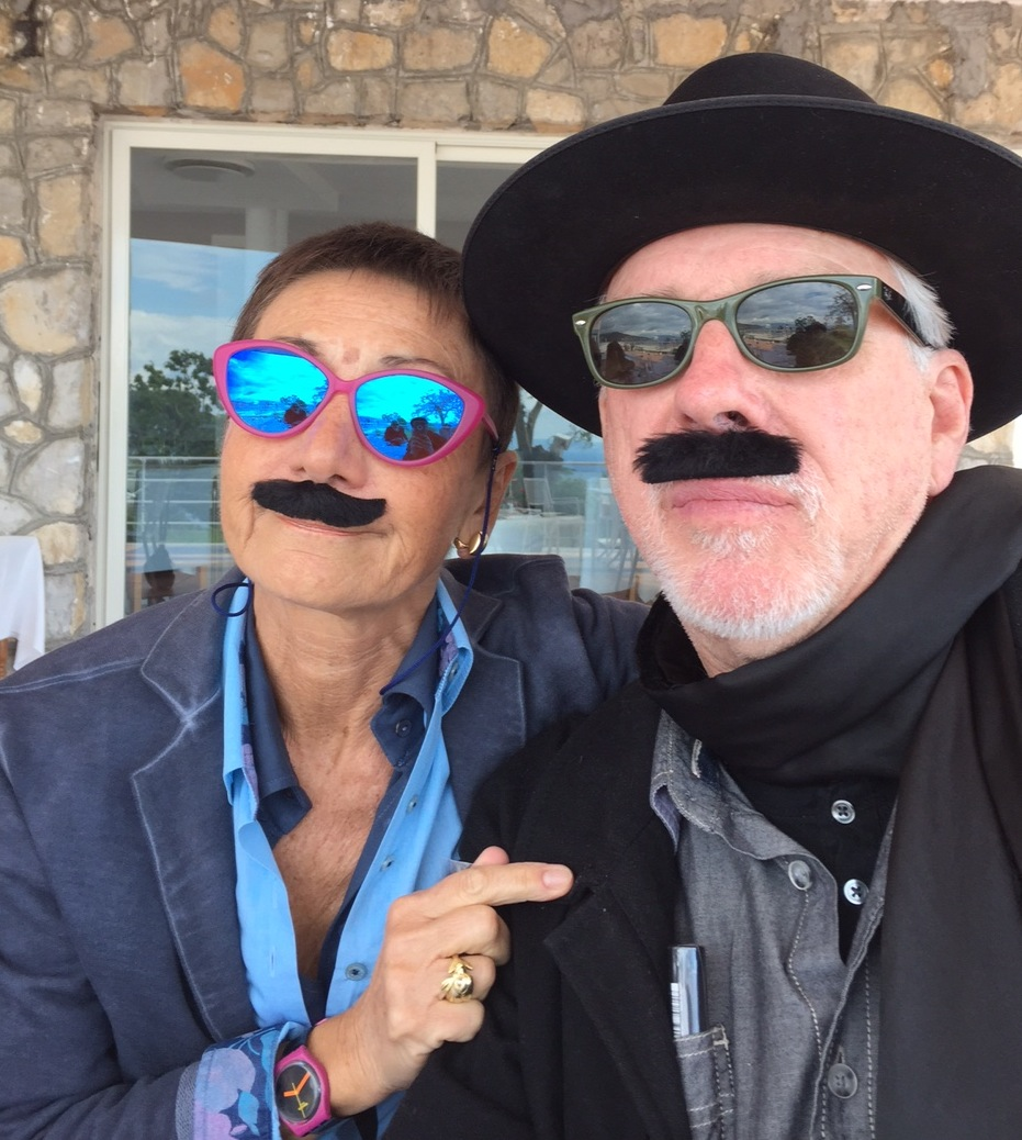 Cynthia Penna + artist Eric Johnson yukking it up, mustachioed.