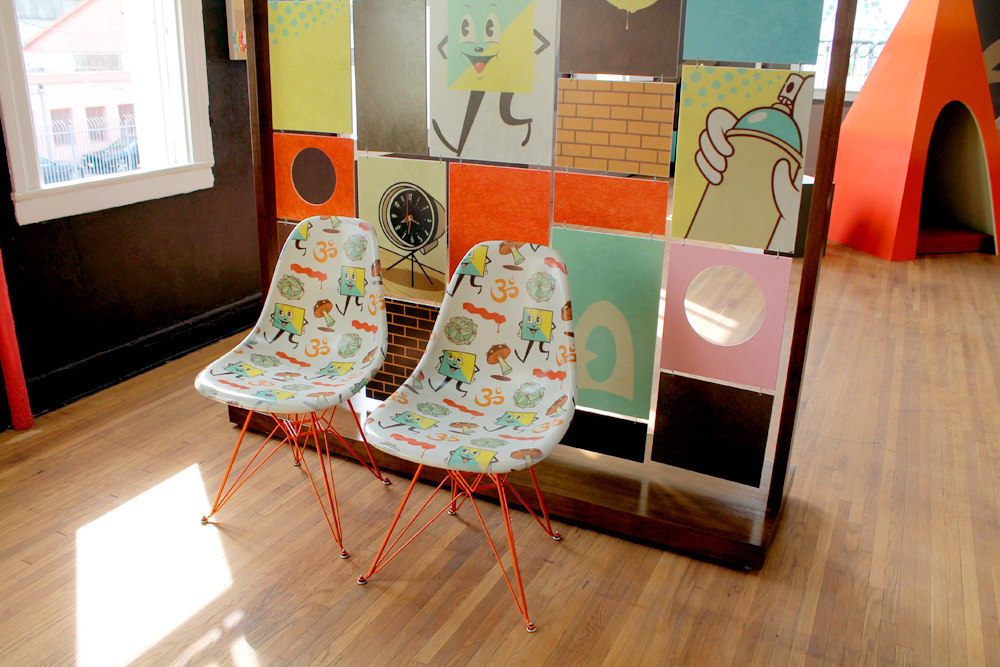 Modernica's collaborative fiberglass chairs, imprinted with Dabs Myla's original designs.