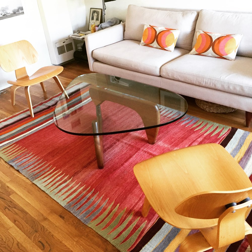 Heather's Noguchi coffee table and Eames molded plywood chairs are now fabulously moored by the colorful Turkish rug we discovered..