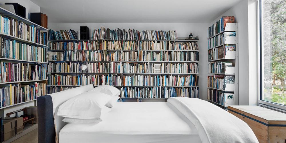 A bibliophile's dream bedroom, belonging to artist Jack Ceglic and architect Manuel Fernandez-Casteleiro.