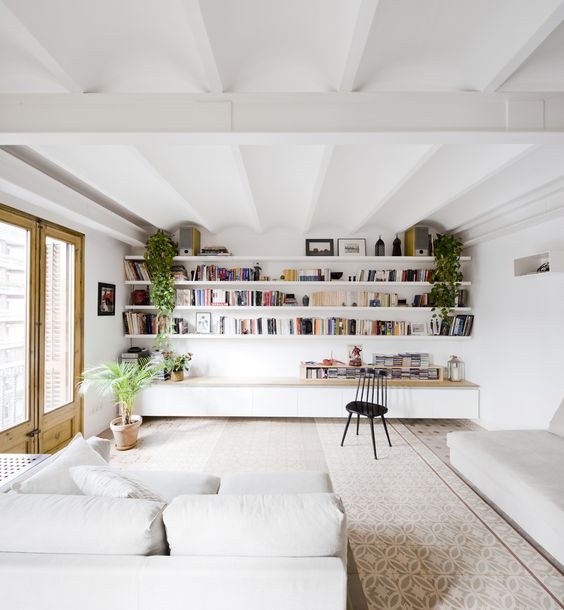 Wall-to-wall shelves in Barcelona, Spain by  Anna Eugeni Bach