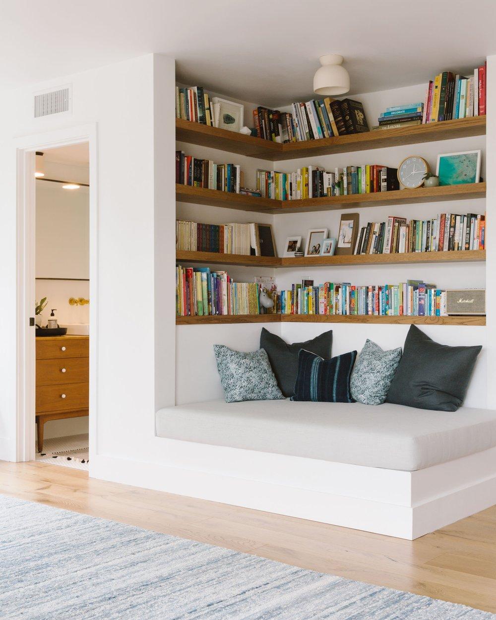 Reading nook utilizing an otherwise blah corner by  Samantha Gluck Interiors .