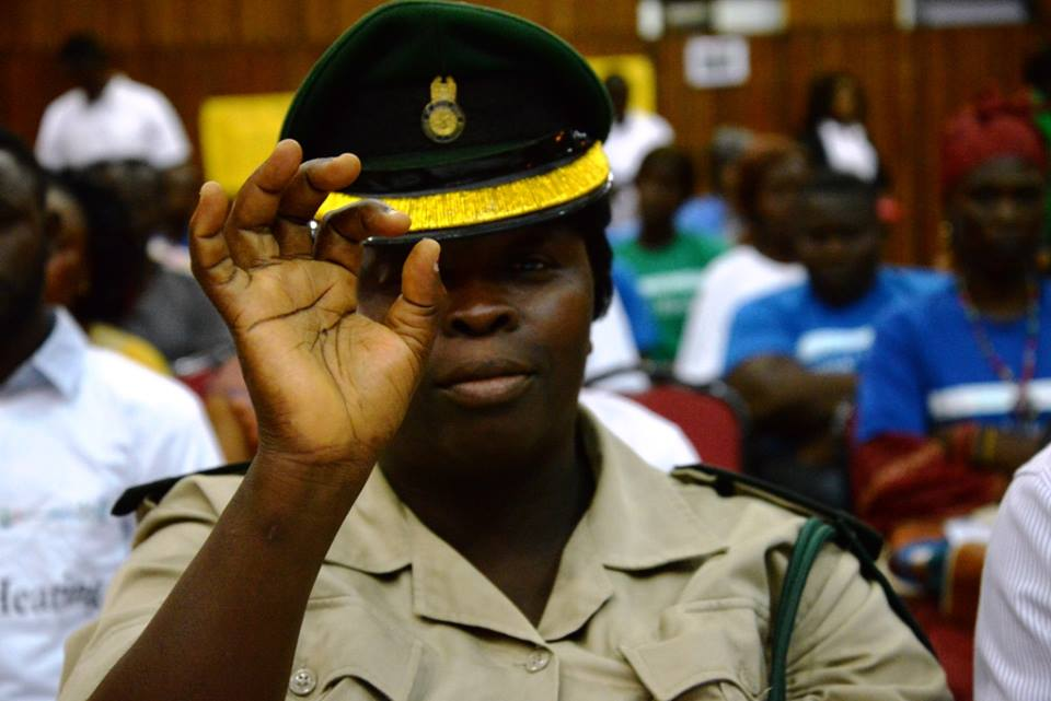 Senior Correctional Officer making 'zero' commitment sign Sierra Leone Bo District.jpg