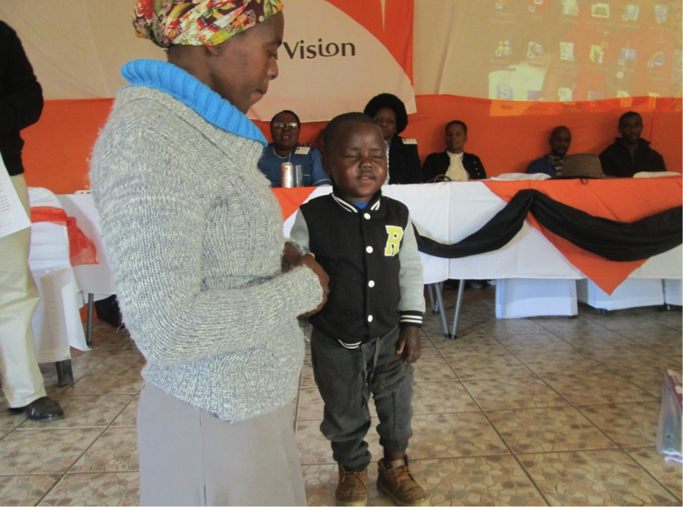 Thalente of Khulakahle crèche is praying for the audience.png
