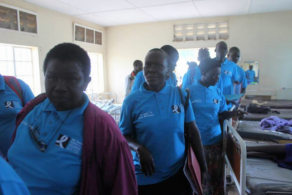 Community monitors in health centre.jpg